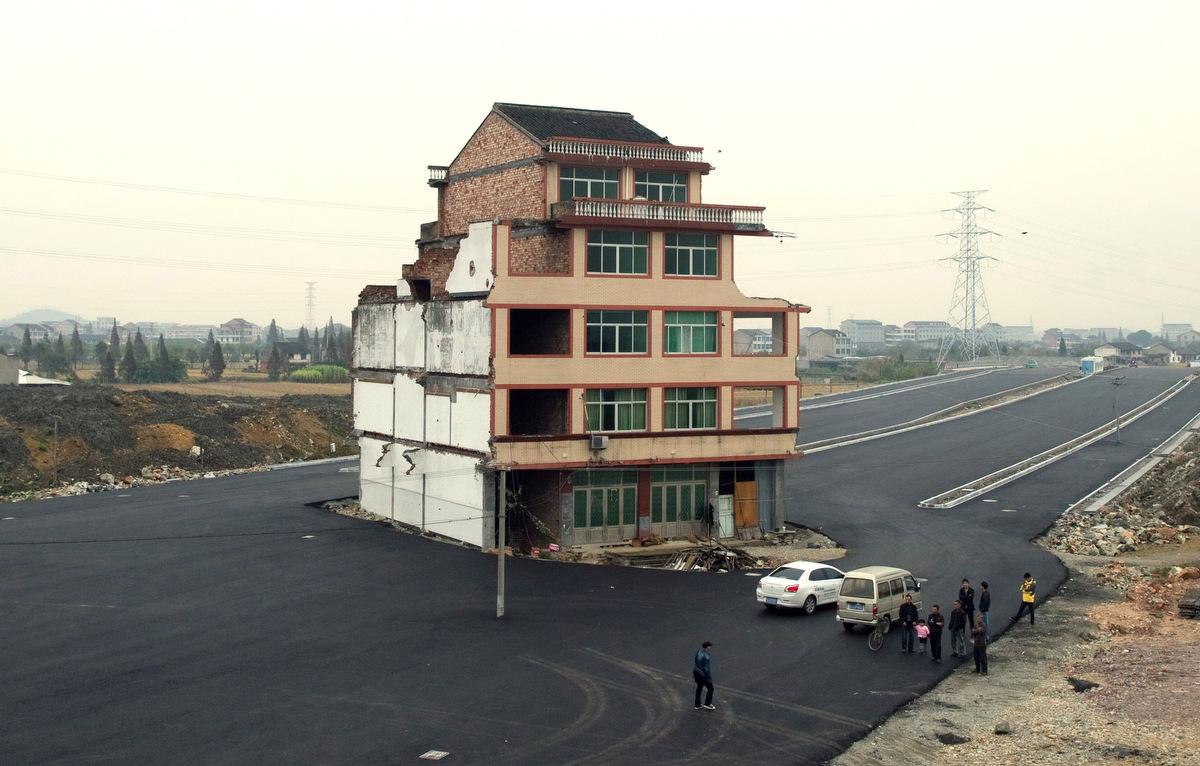 Motorway built around house in China